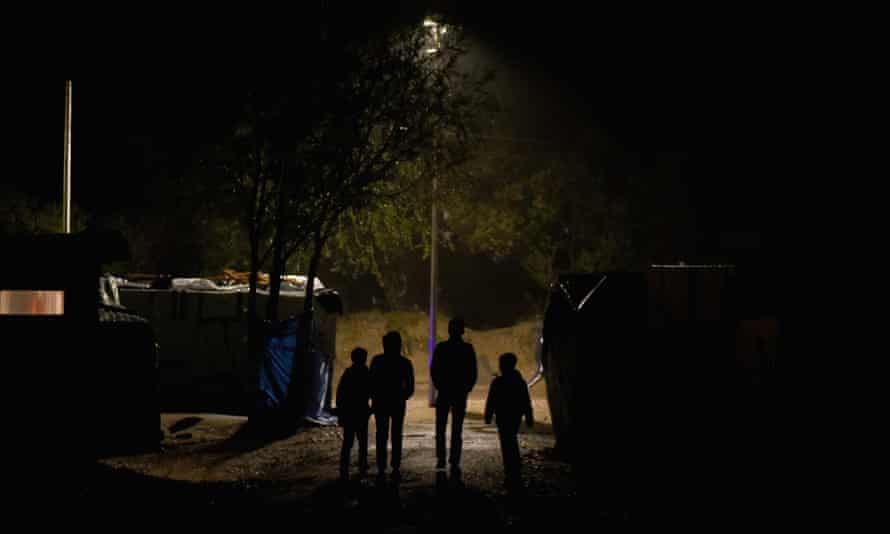 Four young refugees begin their nightly attempt to get to the lorry parks around the port of Calais