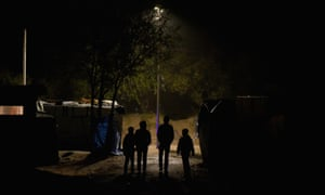 Child refugees leave calais camp at night