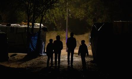 Four children in a refugee camp in Calais