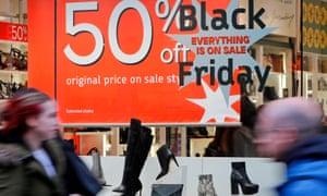 50% off Black Friday shoe shop sign.