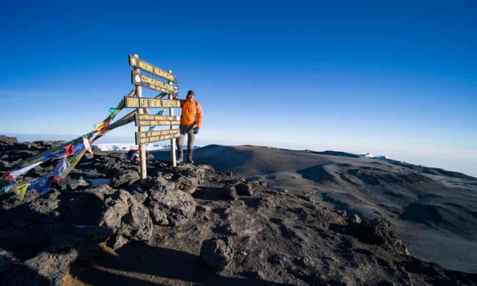 Climber at the summit of Kilimanjaro