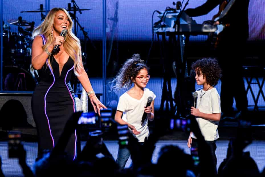 Carey onstage in Atlanta, Georgia, in March 2019, with her children, Monroe and Moroccan Cannon, during her Caution world tour.