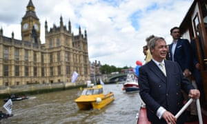 Nigel Farage poses on a passenger boat as he accompanies a Brexit flotiall of fishing boats on the river Thames past the Houses of Parliament.