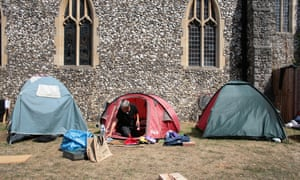 Homeless people camping outside a church in Slough