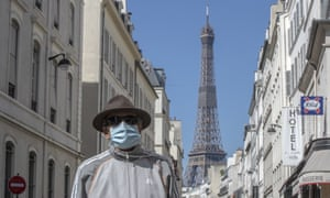 A man weaning a mask to protect against the spread of the coronavirus in Paris.