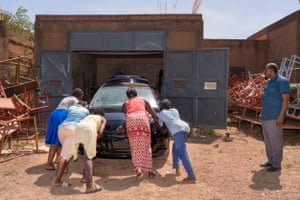 Girls working on a car