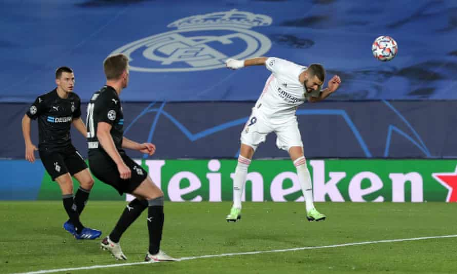 Karim Benzema heads in his and Madrid's second goal as they eased past Borussia Mönchengladbach to top Group B.