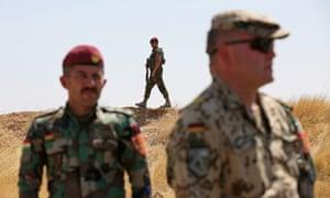 A German Bundeswehr soldier involved in training with Kurdish Peshmerga fighters at Zeravani training camp in Erbil, Iraqi Kurdistan, 21 August 2019.