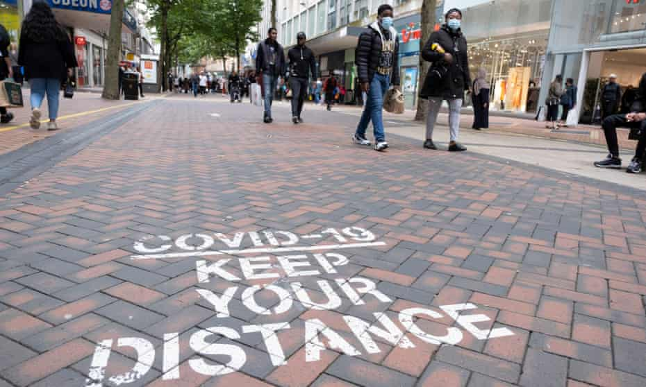 Social distancing sign on pavement in Birmingham