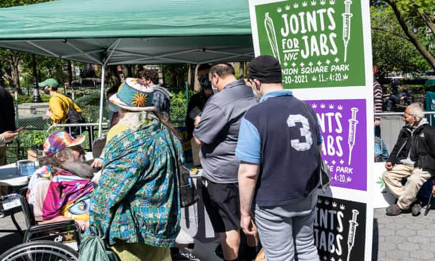 People celebrate legalization of recreational marijuana in New York state on 1 May. There was free distribution of joint for those who showed vaccination proof as well as signing up.