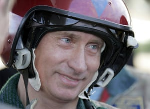 August 2005: Putin arrives at the Olenogorsk military airport, near Murmansk, to fly a Tupolev-160 strategic bomber jet