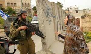 Israeli soldier and Palestinian woman in Hebron