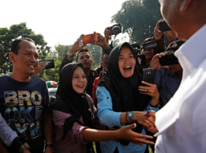 Supporters shake hands with Indonesian presidential candidate Prabowo Subianto.