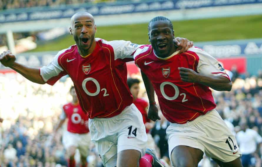 Lauren and Thierry Henry revel in the defender's goal that put Arsenal 2-1 up in their 5-4 win over Tottenham at White Hart Lane in November 2004.