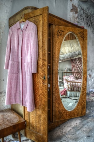 A coat hangs on a wardrobe.