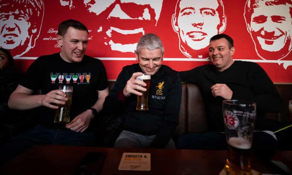 Liverpool fans Dan Wynn, Gerrard Noble and Steve Dodd enjoy a livener before the game at the Flat Iron pub.