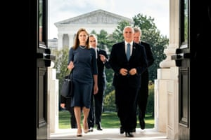 Then judge Amy Coney Barrett and Mike Pence walk up the steps of the US Capitol in Washington DC, on 29 September