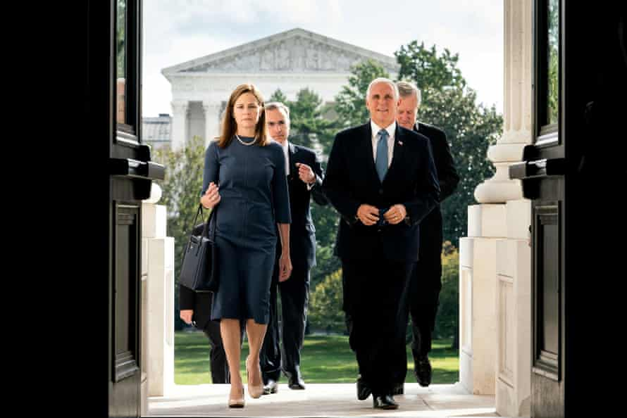 Judge Amy Coney Barrett and Mike Pence walk up the steps of the Capitol in Washington DC on 29 September 2020.