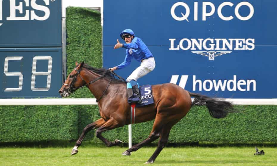 William Buick celebrates win the King George VI And Queen Elizabeth Stakes in style.