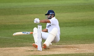 Rishabh Pant falls over after a big swing for the ball.