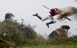 Nina Carberry flies off Sir Des Champs as they fall at The Chair fence during the Grand National steeplechase during day three of the Grand National Meeting at Aintree Racecourse