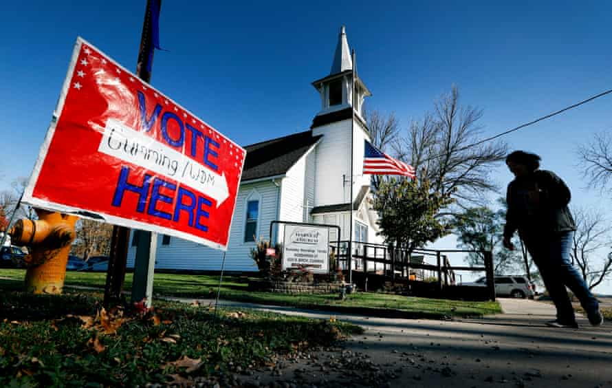 A local resident leaves a church after voting in the general election in Cumming, Iowa on 8 November 2016.