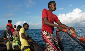 Fishermen pull up the nets in waters off Dar es Salaam in September 2018.