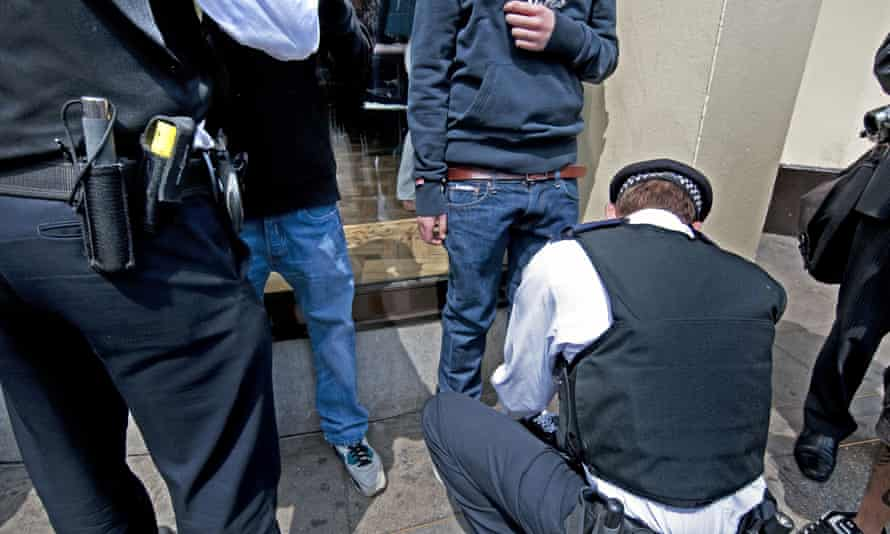 Police stop and search young men on street