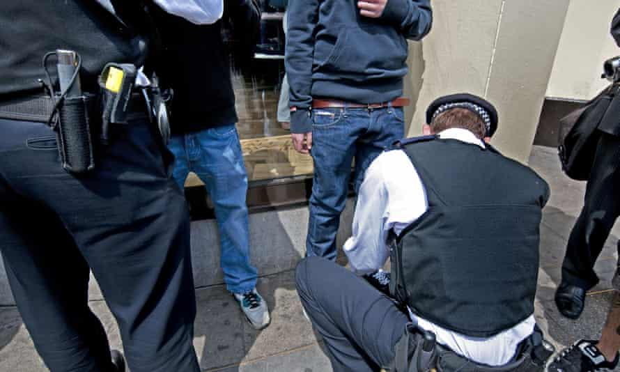 Police stop and search some young men
