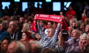 Supporters await Jeremy Corbyn's speech.