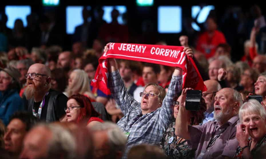 Supporters await Jeremy Corbyn's speech.