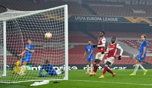 Arsenal's Eddie Nketiah (3rd R) and Nicolas Pepe (2nd R) watch as the ball goes into the net after Molde's Gambian defender Sheriff Sinyan (2nd L) scored an own goal.