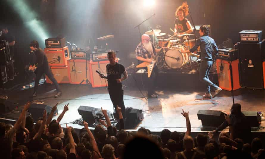 The Eagles of Death Metal on stage in November, minutes before gunmen opened fire and killed 90 people.