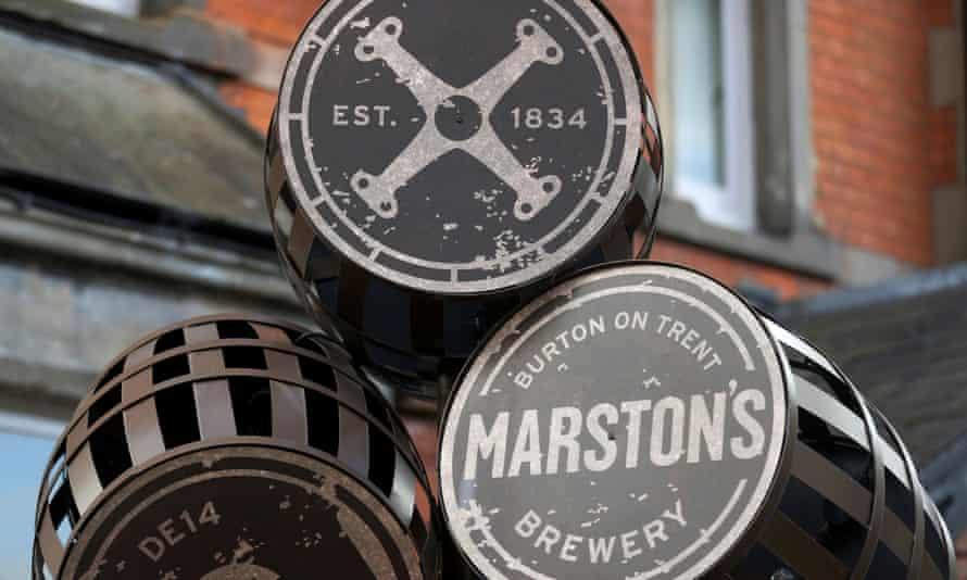 A metal sculpture of Marston's barrels