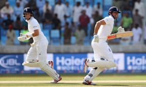 England's Alastair Cook and Joe Root add to their total.