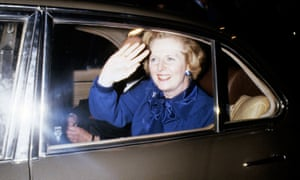 Margaret Thatcher waves from the back of her chauffeur-driven car