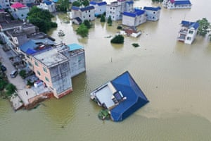 Poyang, China A building is toppled by flood waters in a village near Poyang lake, in Jiangxi province