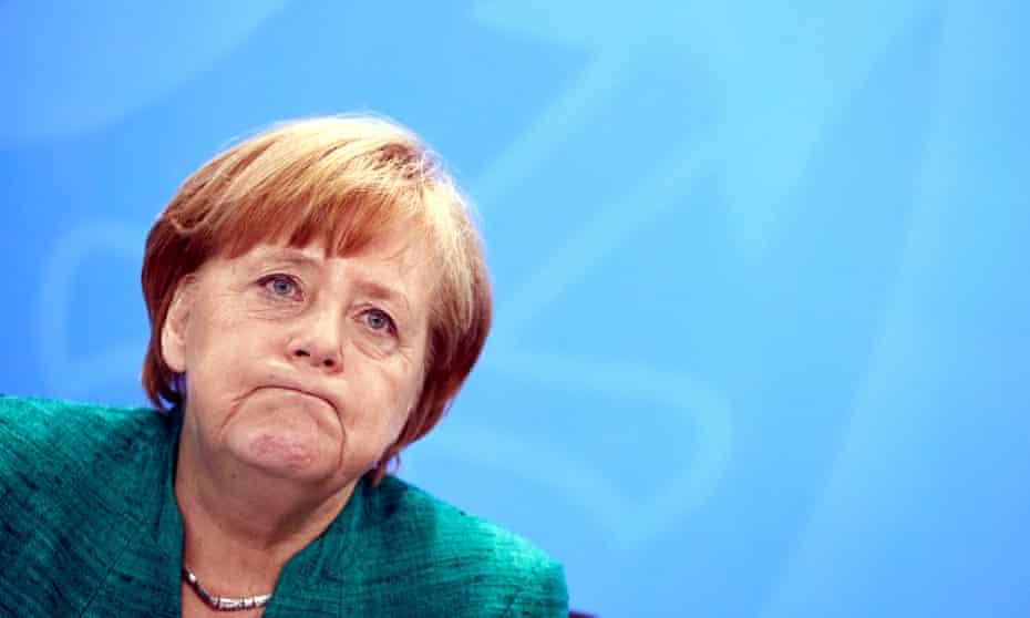 The German chancellor, Angela Merkel, looking unhappy