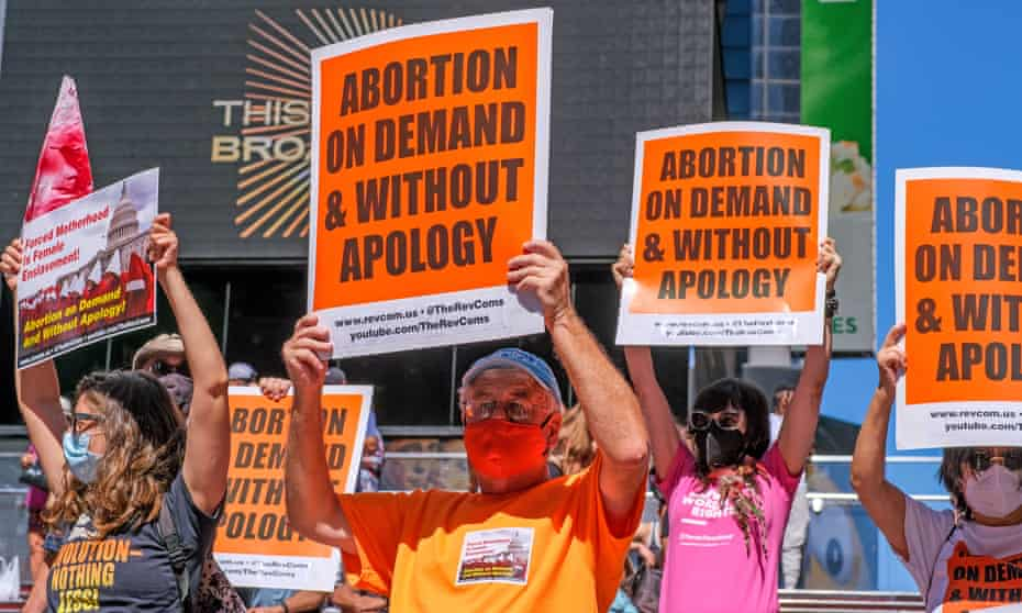 People hold signs protesting the anti-abortion law in Texas on 4 September.