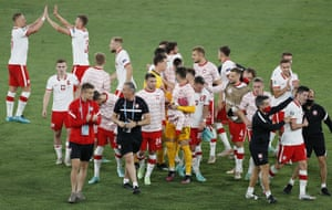 Poland's players and staff, including goalscorer Robert Lewandowski (bottom second right) celebrate after the final whistle.