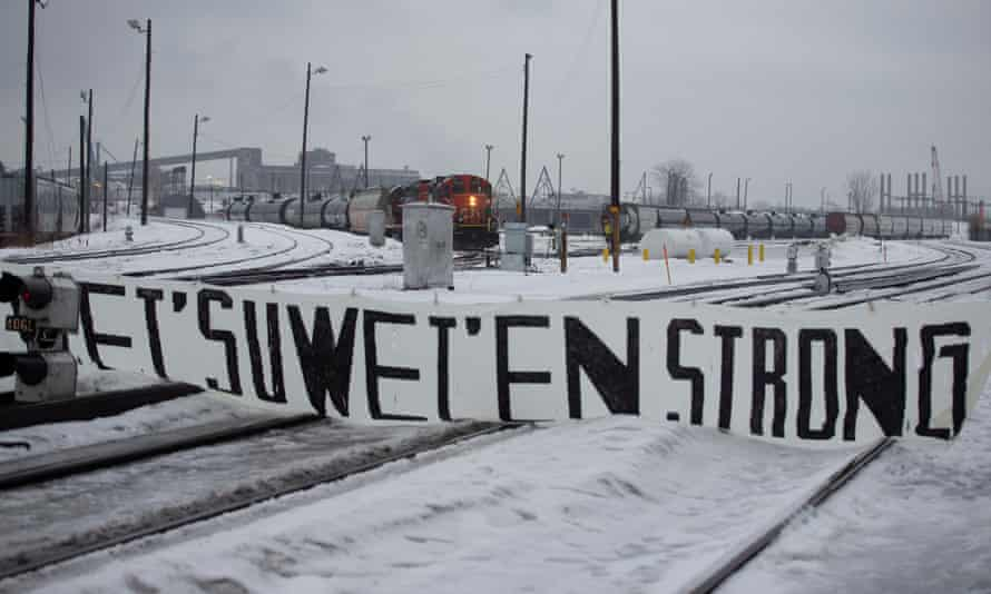A CN train sits on the tracks behind a sign placed by supporters of the Wet'suwet'en Nation at a blockade in Montreal on 2 March.