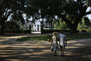 A couple walks through the grounds of the Boone Hall Plantation in Mount Pleasant, South Carolina. The plantation, founded in 1681, is one of the oldest working plantations in the US.
