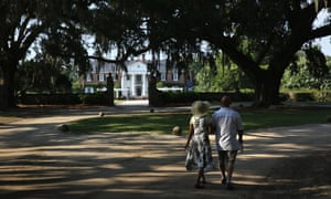 Tradition And Change In The Modern South Carolina<br>MT PLEASANT, SC - JULY 15: A couple walks through the grounds of the Boone Hill Plantation on July 16, 2015 in Mount Pleasant, South Carolina. The plantation, founded in 1681, is one of the oldest working plantations in the United States, once producing cotton and pecans but now fruits and vegetables. The plantation is a popular tourist destination near Charleston, where visitors can tour the main house, the extensive grounds and the former slave quarters. (Photo by John Moore/Getty Images)