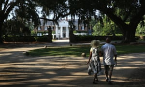 A couple walk through the grounds of the Boone Hill plantation in Mount Pleasant, South Carolina.