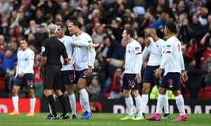 Liverpool players appeal to English referee Martin Atkinson after he allows the opening goal despite a foul on Liverpool's Belgium striker Divock Origi in the build up.