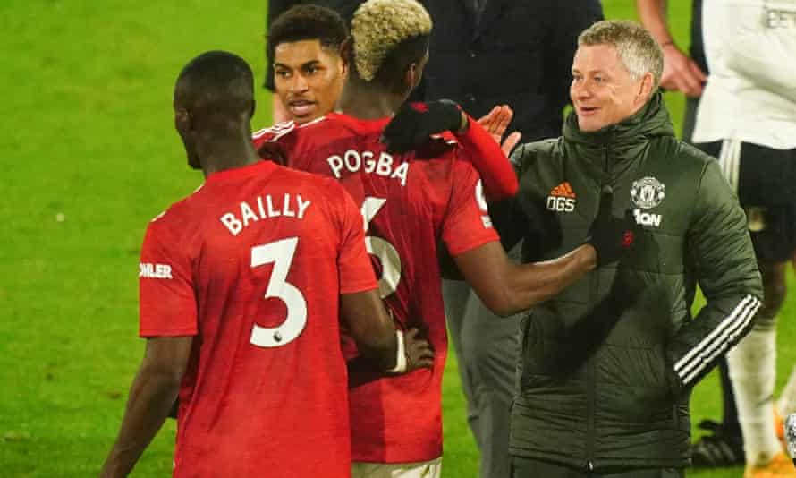 Manchester United's Ole Gunnar Solskjær congratulates Paul Pogba after his decisive role in the win at Fulham.