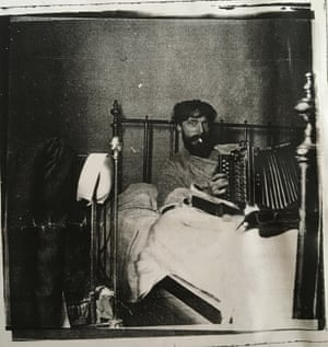 augustus john playing the melodeon in bed