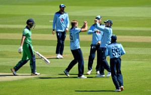 Willey celebrates with teammates after taking the wicket of Balbirnie.