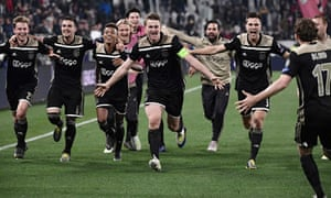 Ajax's captain Matthijs de Ligt (centre) and his teammates celebrate after defeating Juventus 2-1 in their Champions League quarter-final second leg in Turin.