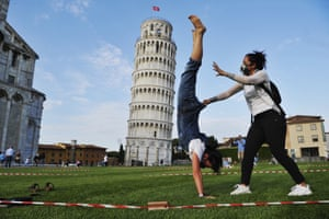 Pisa, Italy: people wear face masks near the leaning tower